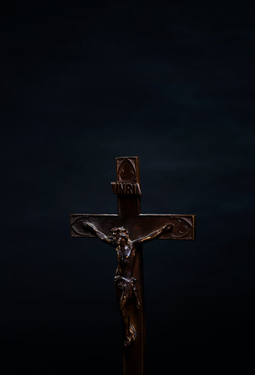 portrait of a wooden cross on black background