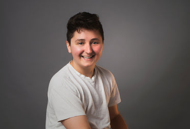 portrait of an androgynous person smiling