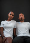 portrait of two people in crisp white shirts