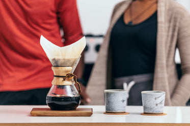 pour over coffee with two rustic cups
