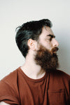 profile of a man with beard and styled hair