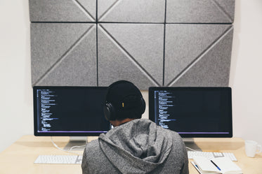 Free Stock Photo of Programmer Focused On Code — HD Images