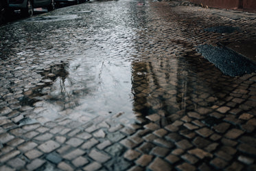 puddle on a cobble street