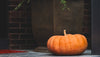 pumpkin sat on the top step of porch