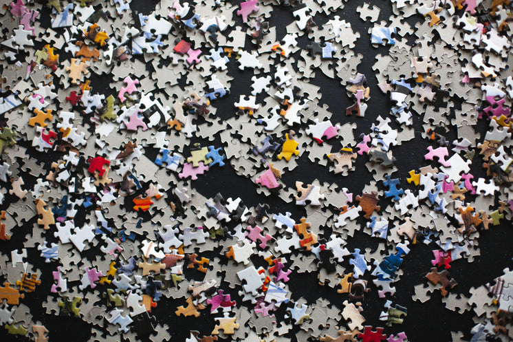 Puzzle Pieces On A Black Background