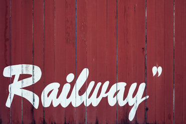railway painted on red barnboard