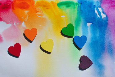rainbow hearts scattered whimsically on watercolour canvas
