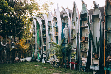 reclaimed canoes as garden decor