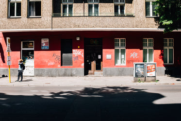 red and brown building with graffiti