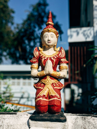 red and gold statue outdoors