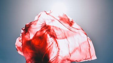 red fabric illuminated by the sun