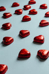 red foiled hearts on a light blue background