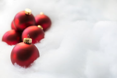 red ornaments on white snow