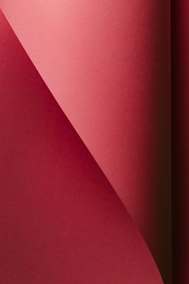 red paper curves to make an abstract gradient
