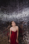 red party dress in silver room