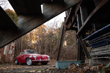 red sports car in the country on a fall day