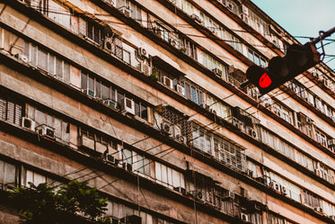 red traffic light and building