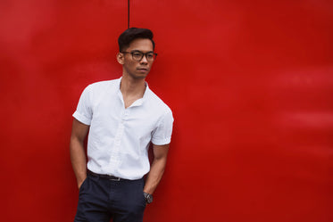 red wall behind men's summer fashion