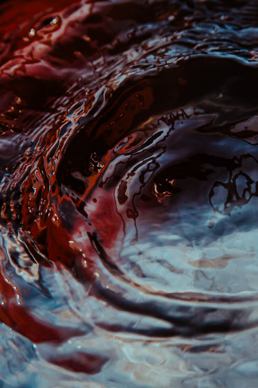 ripples in red waters