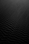 ripples of sand in black and white
