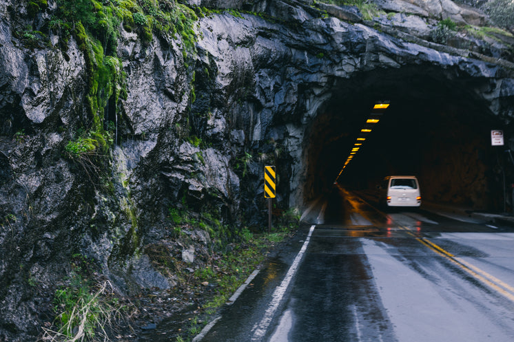 Road And Tunnel Through Mountain