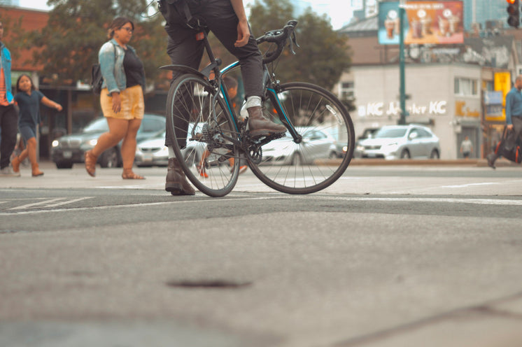 Road Bike And Rider In City