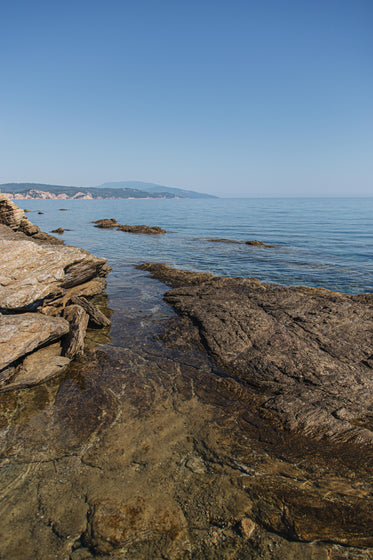 rocky coast with open ocean and blue sky