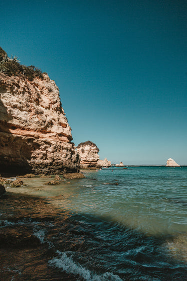 rocky lagos cliffs protrude out into the ocean