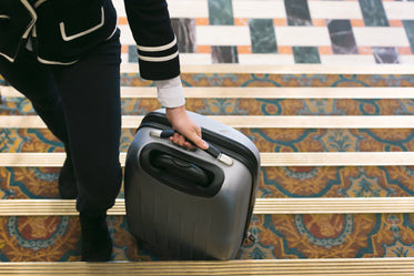 rolling suitcase into hotel