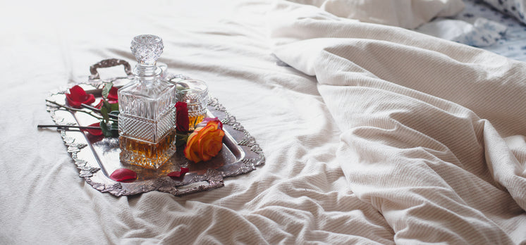 Roses On A Silver Tray Sit Upon A Bed