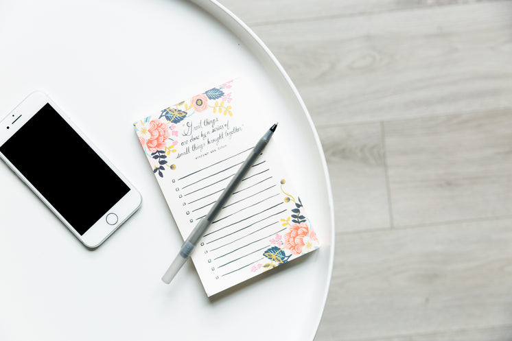 Round White Table With Phone And Notepad