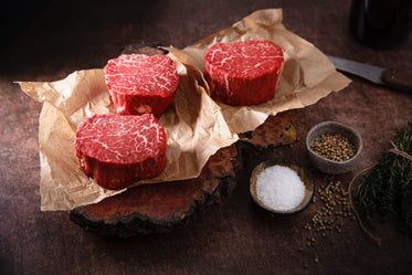 rounds of raw meat on butcher paper