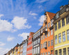 row of colorful buildings on a sunny day