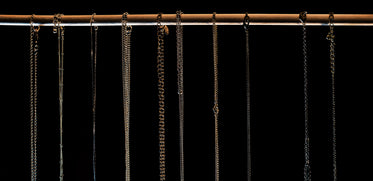 row of necklace chains close up