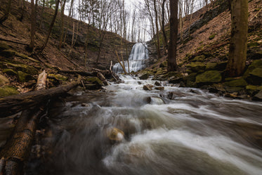 rushing water flows quickly away from cascading waterfalls