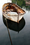 rusted river boat on clear water