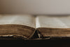 rustic old book open at centre