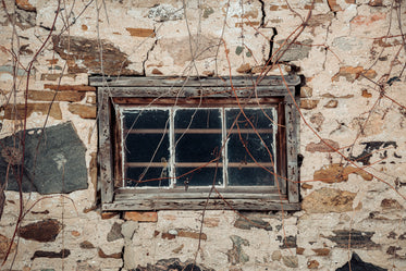 rustic old window in a stone building