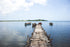 rustic wooden pier on calm lake