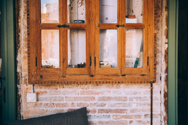 rustic wooden window frame against exposed brick