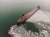 rusting freighter on icy sea