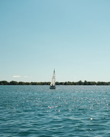 sail floats boat on the water