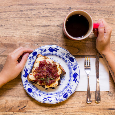 sandwich on plate and cup of coffee
