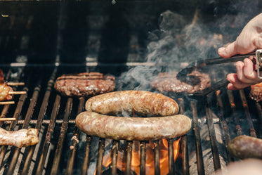 sausages and burgers on a grill