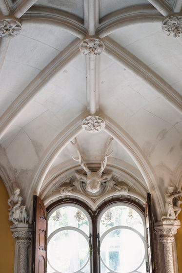 sculpted ceiling over ornate windows