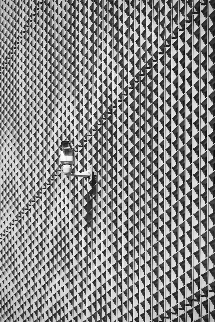 Security Camera On Patterned Building