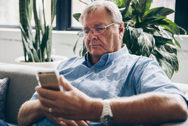 senior using cell phone