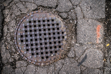 sewer grate in pavement