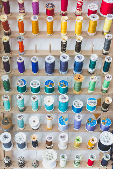 colorful sewing threads on wall
