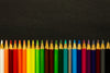 sharp colored pencils lined up in a row